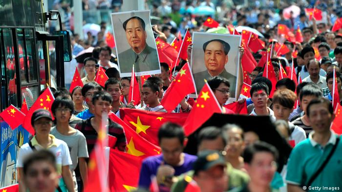 Chinese demonstrators carry national flags and portraits of Mao Zedong during a protest over the islands in Wuhan. Photo: AFP/AFP/GettyImages)