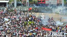 epa03399644 Riot police fire tear gas at protesters outside the city headquarters of Communist Party of China during an anti-Japan protest in Shenzhen in south China's Guangdong province 16 September 2012. Protests across several Chinese cities continued, in the country's ongoing row with Japan over disputed islands in the South China Sea. In the capital, Beijing, several thousand people, mostly young, carried Chinese flags and images of Mao in front of the Japanese embassy. Police were seen in heavy numbers. The demonstrators called on Japan to withdraw from the islands. The dispute between the two countries escalated on Friday when six Chinese ships began patrolling the waters around the islands. EPA/LAN QING CHINA OUT