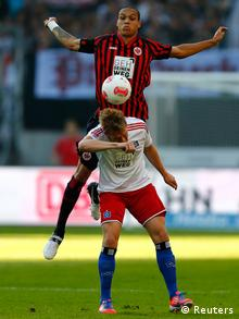 Bamba Anderson (rear) of Eintracht Frankfurt challenges Artjoms Rudnevs of HSV Hamburg during their German first division Bundesliga soccer match in Frankfurt, September 16, 2012. REUTERS/Kai Pfaffenbach (GERMANY - Tags: SPORT SOCCER) DFL RULES TO LIMIT THE ONLINE USAGE DURING MATCH TIME TO 15 PICTURES PER GAME. IMAGE SEQUENCES TO SIMULATE VIDEO IS NOT ALLOWED AT ANY TIME. FOR FURTHER QUERIES PLEASE CONTACT DFL DIRECTLY AT + 49 69 650050