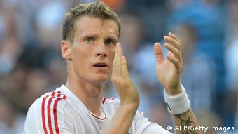 Hamburg's midfielder Marcell Jansen thanks the fans after a pre-season friendly football match between Hamburger SV and FC Barcelona in Hamburg, northern Germany, on July 24, 2012. FC Barcelona won the match 1-2. AFP PHOTO / CARMEN JASPERSEN (Photo credit should read CARMEN JASPERSEN/AFP/GettyImages)