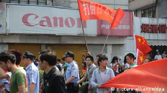 People in an anti-Japan protest (Photo via Newscom picture alliance)