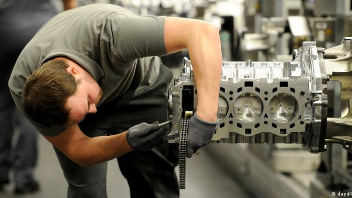 Worker assembling a Porsche engine in Germany