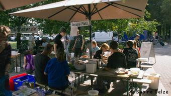 People eating on the Occupy grounds in Münster