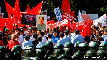 Chinese demonstrators protest outside the Japanese embassy in Beijing, China, EPA/DIEGO AZUBEL