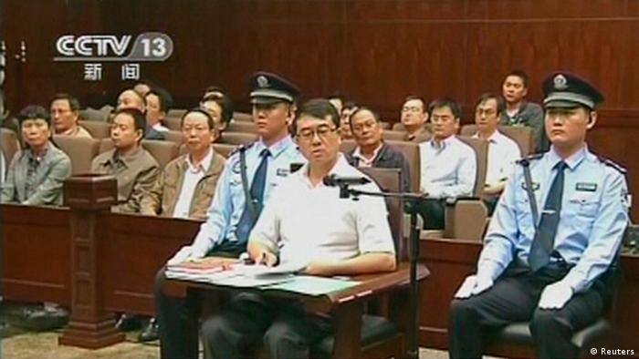 Former police chief Wang Lijun speaks during a court hearing in Chengdu in this still image taken from video September 18, 2012. The former police chief at the heart of China's biggest political uproar in decades did not contest charges against him at his court hearing on Tuesday, an official said. Wang fled to a U.S. consulate in Chengdu for more than 24 hours in February, days after his dismissal as police chief of Chongqing, the nearby municipality then run by ambitious politician Bo Xilai, who had raised Wang to prominence as a crime gang-buster. REUTERS/CCTV via Reuters TV (CHINA - Tags: CRIME LAW POLITICS) FOR EDITORIAL USE ONLY. NOT FOR SALE FOR MARKETING OR ADVERTISING CAMPAIGNS. CHINA OUT. NO COMMERCIAL OR EDITORIAL SALES IN CHINA