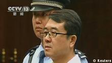 Former police chief Wang Lijun attends a court hearing in Chengdu in this still image taken from video September 18, 2012. The former police chief at the heart of China's biggest political uproar in decades did not contest charges against him at his court hearing on Tuesday, an official said. Wang fled to a U.S. consulate in Chengdu for more than 24 hours in February, days after his dismissal as police chief of Chongqing, the nearby municipality then run by ambitious politician Bo Xilai, who had raised Wang to prominence as a crime gang-buster. REUTERS/CCTV via Reuters TV (CHINA - Tags: CRIME LAW POLITICS TPX IMAGES OF THE DAY) FOR EDITORIAL USE ONLY. NOT FOR SALE FOR MARKETING OR ADVERTISING CAMPAIGNS. CHINA OUT. NO COMMERCIAL OR EDITORIAL SALES IN CHINA