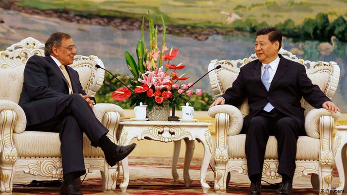 U.S. Secretary of Defense Leon Panetta (L) meets with China's Vice President Xi Jinping REUTERS