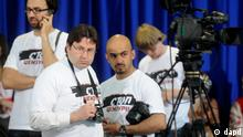 Journalists wearing t-shirts reading Stop censorship seen prior to a news conference of Ukraine's President Viktor Yanukovych in Kiev, Ukraine, Friday, June 4, 2010. International media rights watchdogs have expressed concerns over deterioration of press freedom in Ukraine. (AP Photo/Sergei Chuzavkov)