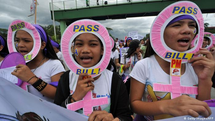 Young women shout pro-reproductive health slogans during a protest march to parliament to mark the 100th International Women's Day in Manila on March 8, 2011, amid a raging debate over a proposed law to allot annual funding for family planning (Photo: TED ALJIBE/AFP/Getty Images)