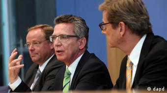 Niebel, de Maiziere and Westerwelle at the press conference Photo: Adam Berry/dapd