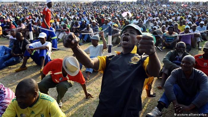A miner celebrating the deal that ended the strike with the Lonmin mine just weeks after the massacre