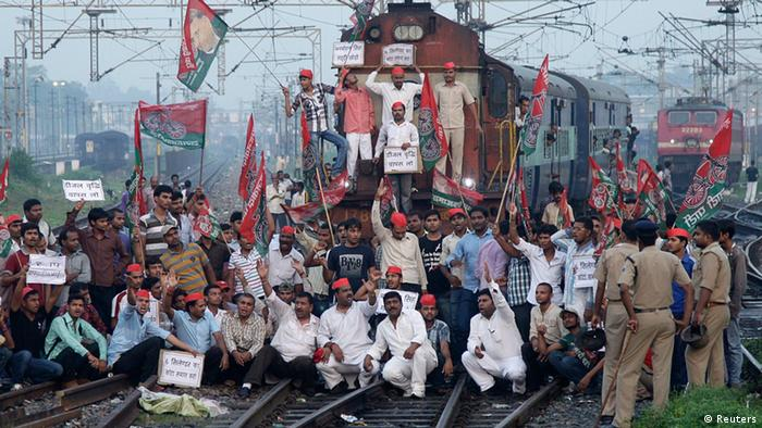 Demonstrators from the Samajwadi Party, a regional political party, shout slogans after they stopped a passenger train during a protest against price hikes in fuel and foreign direct investment (FDI) in retail, near Allahabad railway station September; Photo: REUTERS/Jitendra Prakash