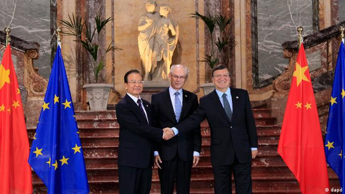 Chinese Premier Wen Jiabao, left, is welcomed by European Commission President Jose Manuel Barroso, right, and European Council President Herman Van Rompuy during an EU-China summit in Brussels on Thursday, Sept. 20, 2012. (AP Photo/Yves Herman, Pool)