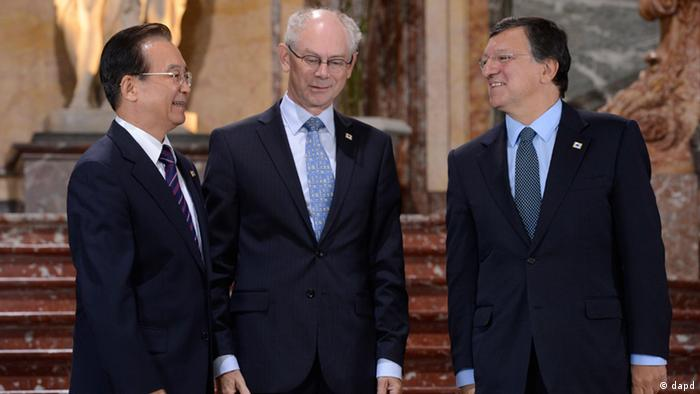 Chinese Premier Wen Jiabao, left, speaks with European Commission President Jose Manuel Barroso, right, and European Council President Herman Van Rompuy during an EU-China summit in Brussels on Thursday, Sept. 20, 2012. (AP Photo/John Thys, Pool)