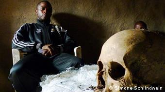 Raia Mutomboki depuity commander Kikuny with skull. Photo: Simone Schlindwein