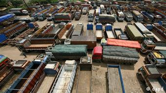 Trucks are parked during a day-long nationwide strike in Chennai, India, Thursday, Sept. 20, Photo: AP Photo/ Arun Sankar.K