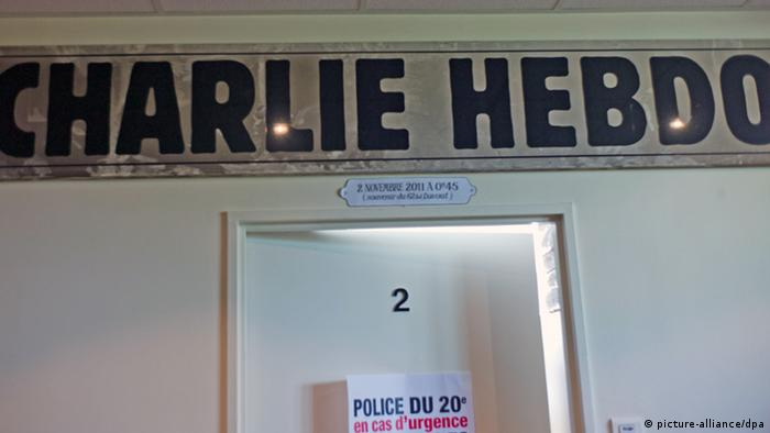 French satirical weekly Charlie Hebdo's office door.