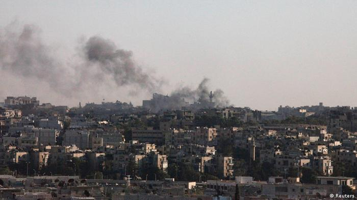 Smoke rises above Aleppo after a heavy jet strike on the city