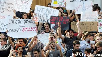 Georgian students hold placards and shout slogans during a protest against torture in prisons in Tbilisi on September 20, 2012. (Photo VANO SHLAMOV/AFP/GettyImages)