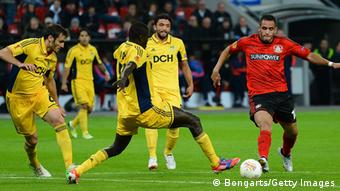 Renato Augusto of Leverkusen is challenged by Papa Gueye of Kharkiv during the UEFA Europa League group K match between Bayer Leverkusen and FC Metalist Kharkiv at BayArena on September 20, 2012 in Leverkusen, Germany. (Photo by Lars Baron/Bongarts/Getty Images)