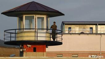 An armed guard is seen by a guard tower at a prison in Tbilisi