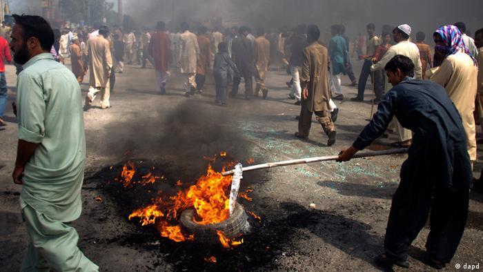Pakistani protesters burn tires to block the main highway in Rawalpindi, Pakistan on Friday, September 21 (Photo: AP Photo/ B.K. Bangash)