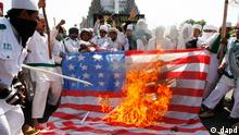 Muslim protesters burn an American flag during a protest against an anti-Islam film produced in the United States in Makassar, South Sulawesi province, Indonesia, Friday, Sept, 21, 2012. The U.S. has closed its diplomatic missions across Indonesia due to continuing demonstrations over the film Innocence of Muslims, which denigrates the Prophet Muhammad. (AP Photo/Abbas Sandji)