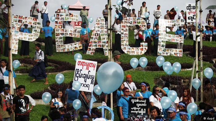 Participants gather to mark the International Day of Peace in Yangon, Myanmar, Friday, Sept. 21, 2012. (AP Photo/Khin Maung Win)