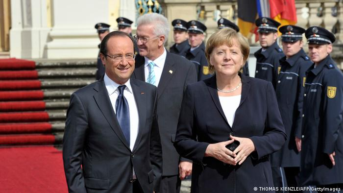 German Chancellor Angela Merkel and French President Francois Hollande arrive at the Baroque palace of Ludwigsburg, southwest Germany, on September 22, 2012 for a ceremony to mark a watershed 1962 speech by Charles de Gaulle, then President of France, to German youth in Ludwigsburg. AFP PHOTO / THOMAS KIENZLE (Photo credit should read THOMAS KIENZLE/AFP/GettyImages)