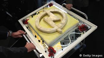 RUESSELSHEIM, GERMANY - SEPTEMBER 22: Employees wheel in a cake decorated with the Opel logo at the Opel Insignia and Astra factory during a celebration marking Opel's 150th anniversary on September 22, 2012 in Ruesselsheim, Germany. The troubled carmaker, which has been owned by General Motors (GM) since the 1920s, is struggling to return to profits and reassert its brand imagery. (Photo by Sean Gallup/Getty Images)