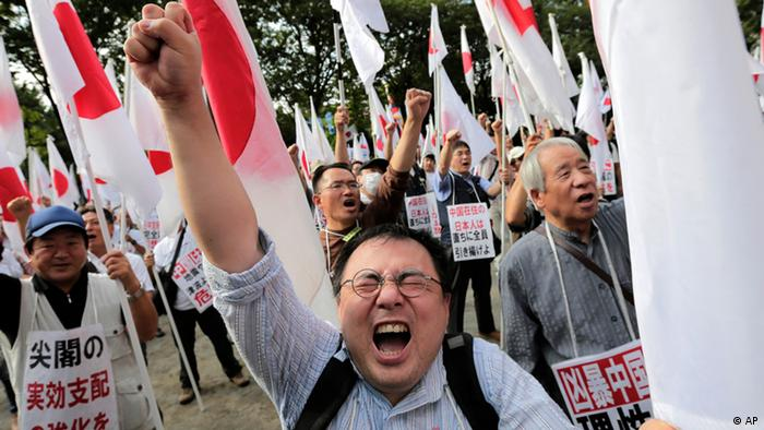 Japanese protesters shout slogans during a rally, opposing China's territorial claim over the disputed islands, called Senkaku in Japan and Diaoyu in China, at a park in Tokyo, Saturday, Sept. 22, 2012 (Photo: Itsuo Inouye/AP/dapd)