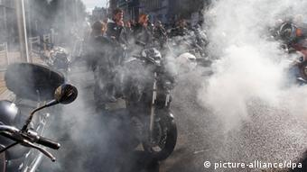 epa03406492 European bikers take part in a protest in Brussels, Belgium, 22 September 2012. Reports state that thousands of bikers gathered in Brussels to protest against an European Commission proposal which will include all types of two wheel powered vehicles to receive regulatory periodic roadworthiness tests and will call for mandatory technical inspections for all motorcycles. EPA/THIERRY ROGE