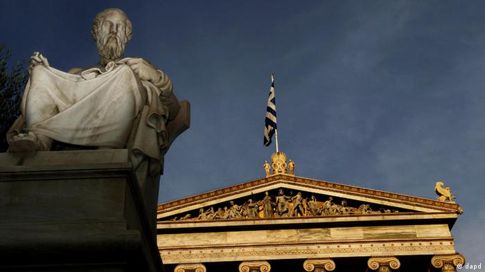 In this photo taken Friday, Oct. 21, 2011, a marble statues of ancient Greek philosopher Plato is seen on a plinth in front of the Athens Academy, as the Greek flag flies. More than 200 international philosophers braved strikes and protests to come to Greece this month to join a forum and debate matters of the mind. Greece's illustrious ancient thinkers built the foundations of Western scholarship, and their philosophy stands as an unquantifiable source of national wealth even during a financial crisis. (Foto:Petros Giannakouris/AP/dapd)