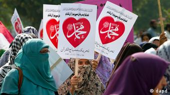 Women supporters of Pakistani religious group Tehreek-e-Minhaj-ul-Qaran participate in a demonstration