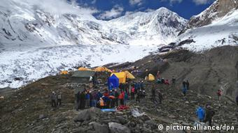 People gathered at the base camp of Mount Manasalu after the avalanche. Photo: EPA/SIMRIK AIR / HANDOUT