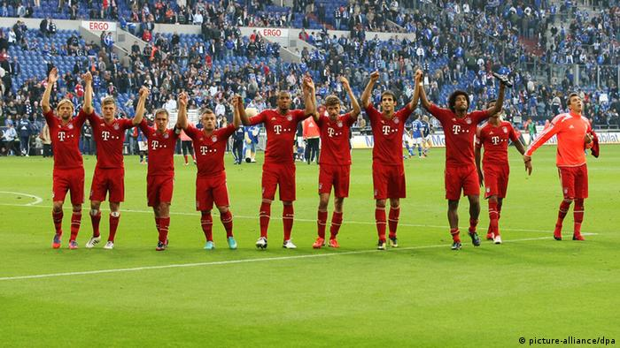 Bayern players salute the fans after beating Schalke 2-0