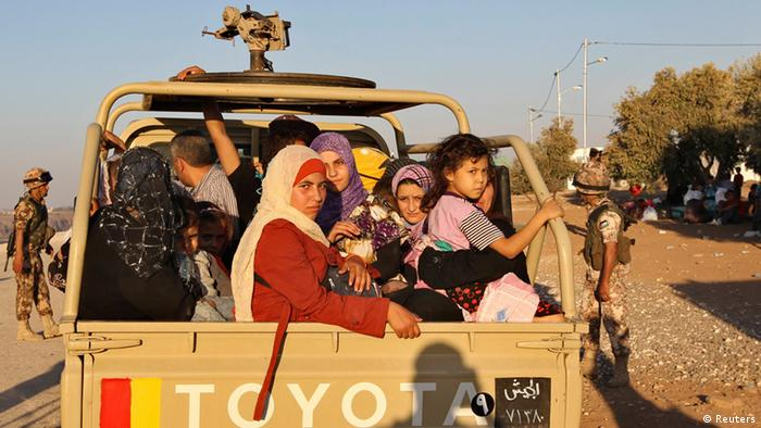 A Jordanian army car carrying Syrian refugees fleeing violence in their country after they crossed into Jordanian territory with their families from Syria into Jordan, near the town of Ramtha September 15, 2012. REUTERS/Muhammad Hamed (JORDAN - Tags: POLITICS CONFLICT SOCIETY IMMIGRATION)