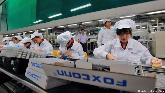 Workers at a Foxconn factory on the assembly line