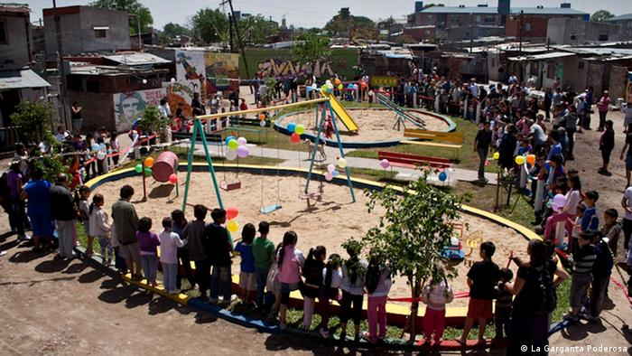Plaza Kevin playground encircled by children and adults
