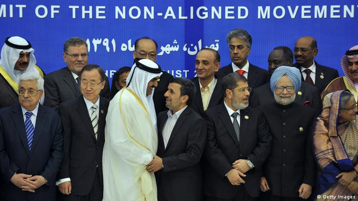 Palestinian president Mahmud Abbas, UN Chief Ban Ki-moon, Qatari Emir Sheikh Hamad bin Khalifa al-Thani, Iranian President Mahmoud Ahmadinejad, Egyptian President Mohamed Morsi, Indian Prime Minister Manmohan Singh and Prime Minister of Bangladesh Sheikh Hasina stand amid other leaders and delegates of the Non-Aligned Movement (NAM) as they pose for a family photo before the start of the NAM summit in Tehran on August 30, 2012. AFP PHOTO/ISNA/AMIR KHOLOUSI (Photo credit should read AMIR KHOLOUSI/AFP/GettyImages)