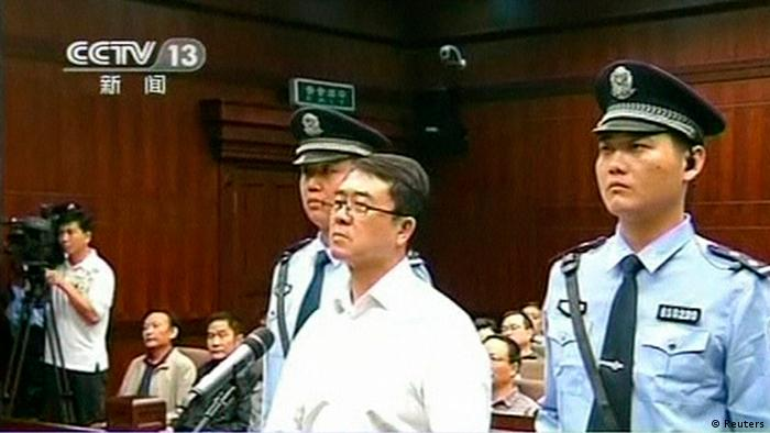 Chongqing municipality ex-police chief Wang Lijun (C) looks on during his sentencing inside the courtroom of the Chengdu People's Intermediate Court in Chengdu, Sichuan province in this still image taken from video September 24, 2012. Wang was found guilty on four charges, including seeking to conceal the murder of a British businessman Neil Heywood in a scandal that felled the ambitious politician Bo Xilai. REUTERS/CCTV via REUTERS TV (CHINA - Tags: CRIME LAW POLITICS) FOR EDITORIAL USE ONLY. NOT FOR SALE FOR MARKETING OR ADVERTISING CAMPAIGNS. CHINA OUT. NO COMMERCIAL OR EDITORIAL SALES IN CHINA