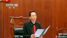 A judge reads out the verdict during the sentencing of Chongqing municipality ex-police chief Wang Lijun (not pictured) inside the courtroom of the Chengdu People's Intermediate Court in Chengdu, Sichuan province in this still image taken from video September 24, 2012. Wang, sentenced to 15 years in jail, was found guilty on four charges, including seeking to conceal the murder of a British businessman Neil Heywood in a scandal that felled the ambitious politician Bo Xilai. REUTERS/CCTV via REUTERS TV (CHINA - Tags: CRIME LAW POLITICS) FOR EDITORIAL USE ONLY. NOT FOR SALE FOR MARKETING OR ADVERTISING CAMPAIGNS. CHINA OUT. NO COMMERCIAL OR EDITORIAL SALES IN CHINA