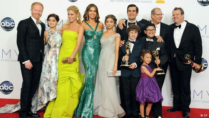 The cast of Modern Family, from left, Jesse Tyler Ferguson, Ariel Winter, Julie Bowen, Sofía Vergara, Sarah Hyland , Ty Burrell, background, Nolan Gould, Ed O'Neill, background second left, Rico Rodriguez, Aubrey Anderson-Emmons, foreground purple dress, and Eric Stonestreet, right, winners of the best outstanding comedy series, pose backstage at the 64th Primetime Emmy Awards at the Nokia Theatre on Sunday, Sept. 23, 2012, in Los Angeles. (Photo by Jordan Strauss/Invision/AP)