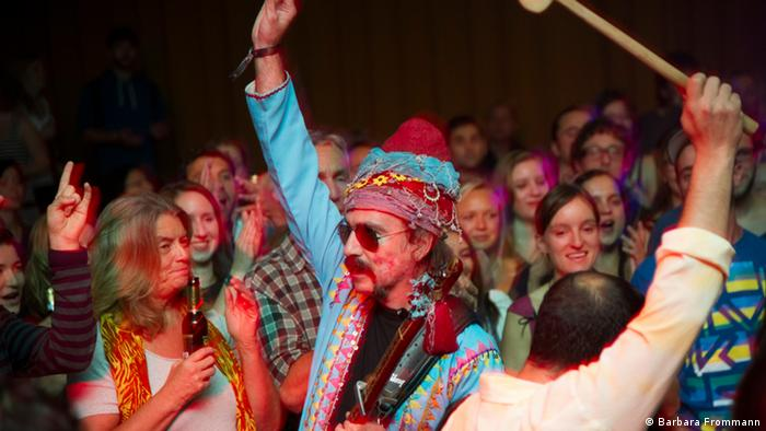 Baba Zula dancing with the crowd at a show Copyright: Barbara Frommann