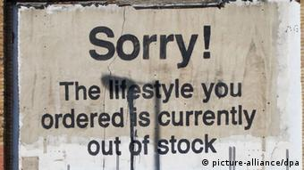 Graffiti in London reading: Sorry! The lifestyle you ordered is currently out of stock. (Photo: Daniel Karmann dpa)