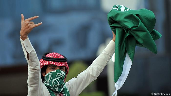 A Saudi youth holds up a folded national flag during celebrations of the 81st Saudi Arabian National Day in the desert kingdom's capital Riyadh on September 23, 2011. AFP PHOTO/FAYEZ NURELDINE (Photo credit should read FAYEZ NURELDINE/AFP/Getty Images)