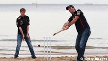 MELBOURNE, AUSTRALIA - MARCH 14: (L-R) Sebastian Vettel of Germany and Red Bull Racing and Mark Webber of Australia and Red Bull Racing try their hand at beach cricket on St Kilda Beach during previews to the Australian Formula One Grand Prix on March 14, 2012 in Melbourne, Australia. (Photo by Mark Thompson/Getty Images)