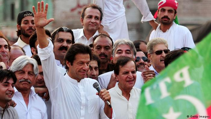 Imran Khan (C), chairman of Pakistan Tehreek-e-Insaf party, waves during a protest rally against the reopening of the NATO supply route to Afghanistan, in Peshawar on July 14, 2012 (Photo: A Majeed/AFP/GettyImages)
