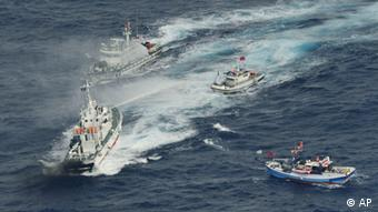 A Japan Coast Guard's patrol boat, left bottom, discharges water against Taiwanese fishing boats near disputed islands called Senkaku in Japan and Diaoyu in China, in the East China Sea, Tuesday, Sept. 25, 2012. (Kyodo News/AP/dapd)