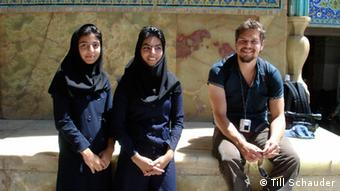 Till Schauder with two young women in Iran
